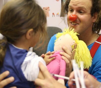 clown with child receiving a shot